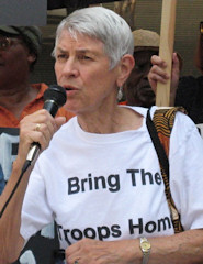 Ruth Schmidt at the microphone, speaking out  for peace.