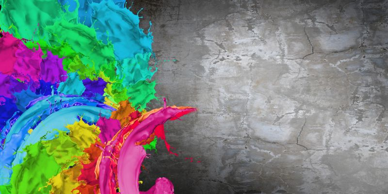 Colors splashed on a dirty wall