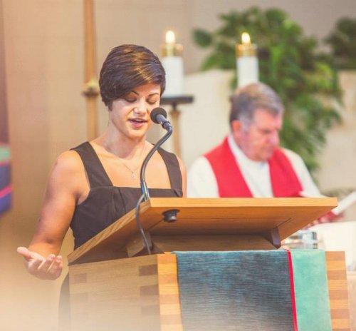 Emmy Kegler praying at an ordination in 2014